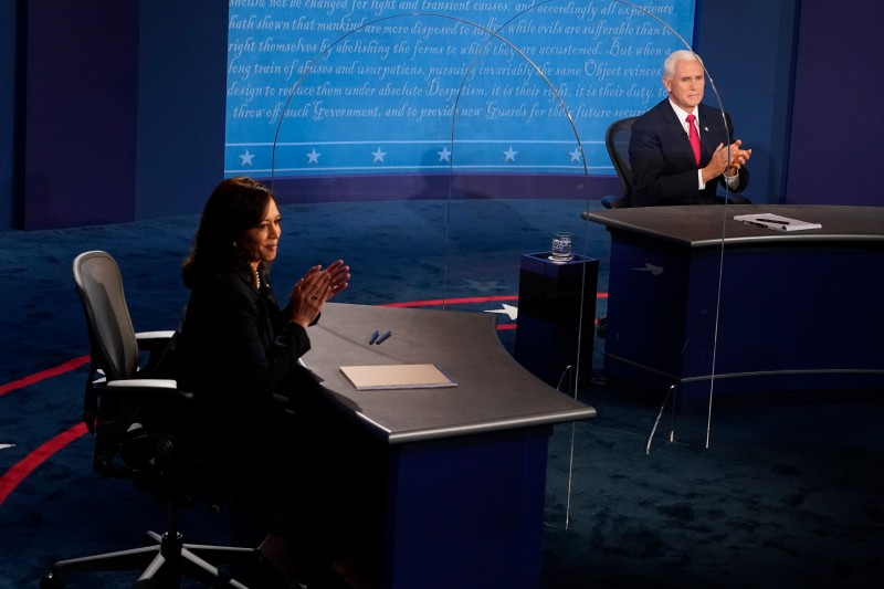 Democratic vice presidential nominee Sen. Kamala Harris (D-CA) and U.S. Vice President Mike Pence applaud after their debate at the University of Utah on October 7, 2020 in Salt Lake City, Utah. (Morry Gash-Pool/Getty Images)