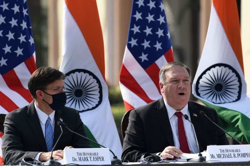 U.S. Secretary of State Mike Pompeo speaks as Secretary of Defense Mark Esper watches during a joint press briefing in the lawns of Hyderabad House in New Delhi on Oct. 27, 2020.