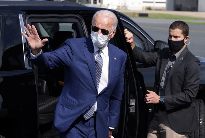 Joe Biden waves as he arrives at New Castle County Airport for his trip to Kenosha, Wisconsin, Sept. 3, 2020 in New Castle, Delaware.