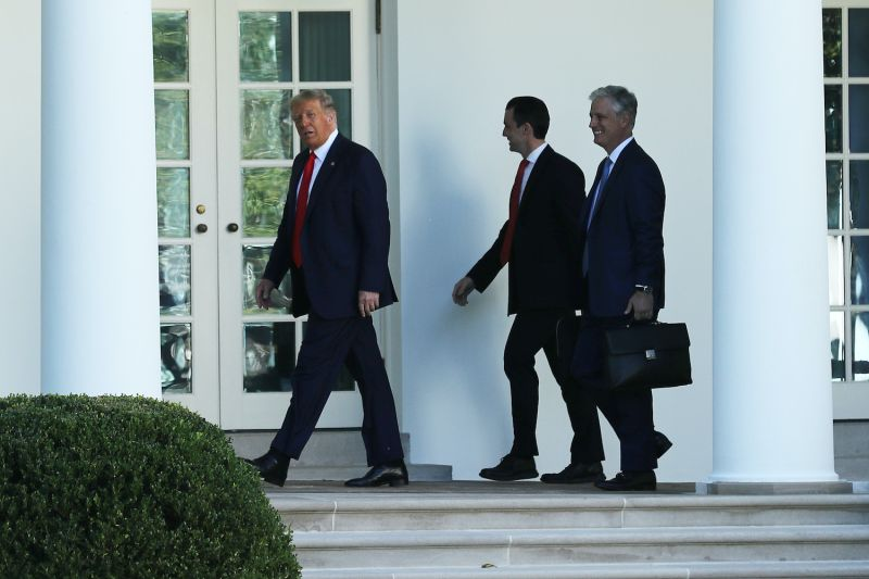 U.S. President Donald Trump and National Security Advisor Robert O'Brien walk along the Rose Garden colonnade before departing the White House on Sept. 21 in Washington.