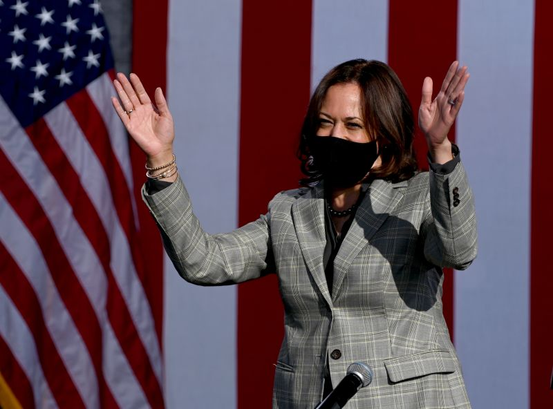 Democratic vice presidential nominee Sen. Kamala Harris waves as she arrives at a voter mobilization drive-in event at the University of Nevada, Las Vegas in Las Vegas on Oct. 2.