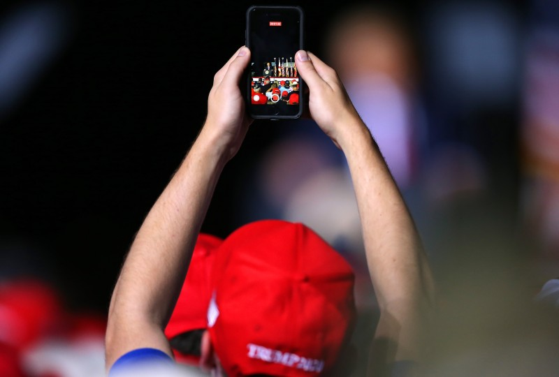 A supporter uses a mobile phone to take a picture during a rally for U.S. President Donald Trump on Oct. 23, 2020 in Pensacola, Florida.
