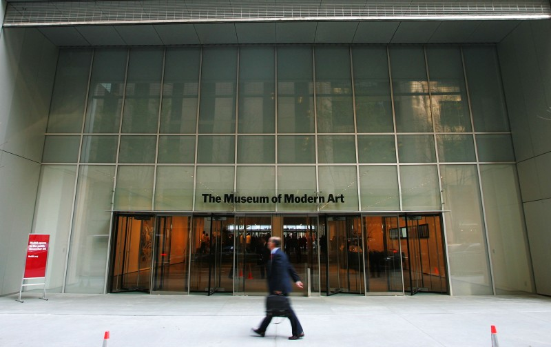 A pedestrian walks outside the entrance to the new Museum of Modern Art building on 53rd Street on Nov. 17, 2004 in New York City.