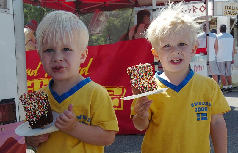 Brothers Fred and Hugo Svenleen of Sweden enjoy an ice cream during the 31st annual Twins Day Festival 05 August, 2006, in Twinsburg, Ohio.