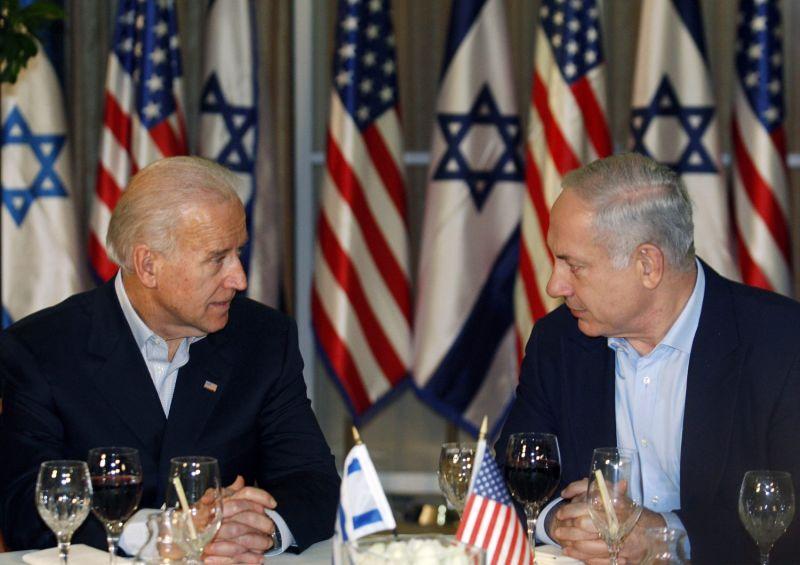 Then-U.S. Vice President Joe Biden (left) sits with Israel's Prime Minister Benjamin Netanyahu