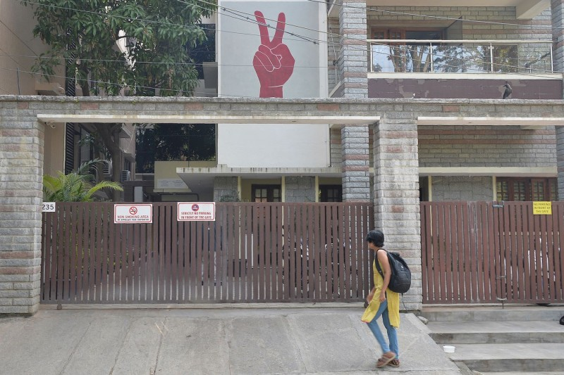 A pedestrian walks past the Amnesty International office in Bengaluru on Oct. 26, 2018.