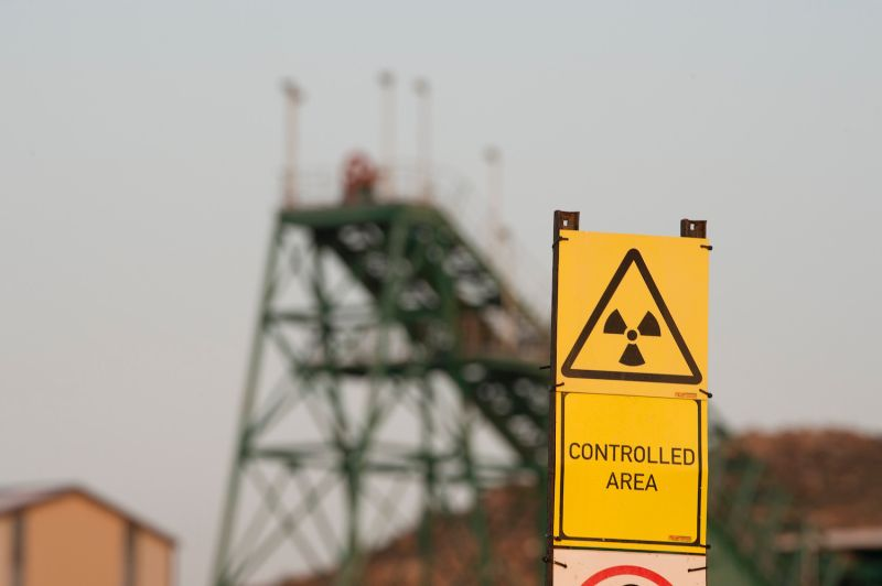 A radioactivity warning sign stands in front of the Steenkampskraal rare earth mine outside of Vanrhynsdorp, South Africa on July 29, 2019.