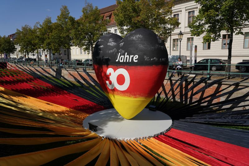 "A sculpture of a heart in the colors of the German flag reads ""30 years"" as part of an outdoor exhibition marking the upcoming 30th anniversary of German reunification in Potsdam on Sept. 17."