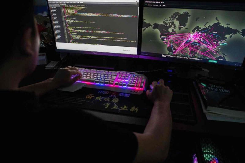 A member of the hacking group Red Hacker Alliance monitors global cyberattacks on his computer at an office in Dongguan, China, on Aug. 4.