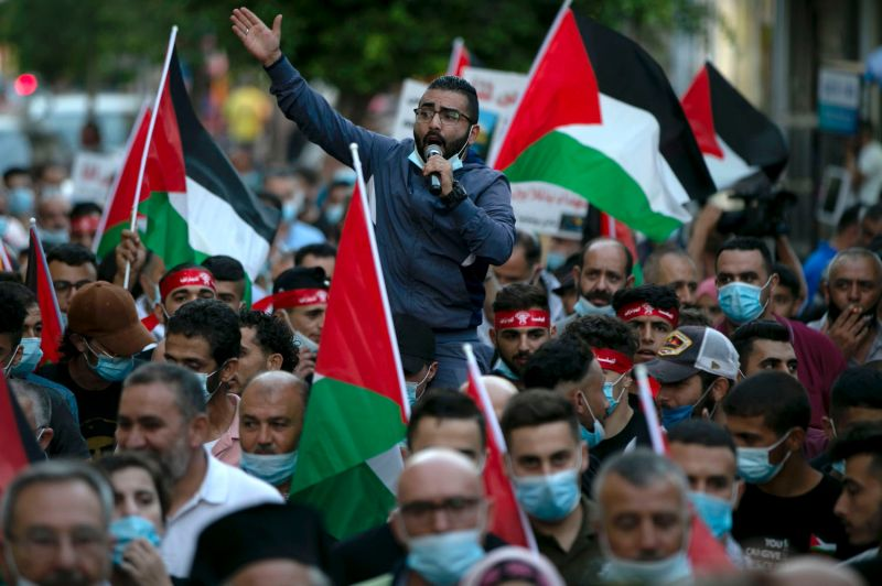 Palestinians gather to commemorate the Second Intifada and to protest the Israeli normalization deals in the occupied West Bank on Sept. 28.