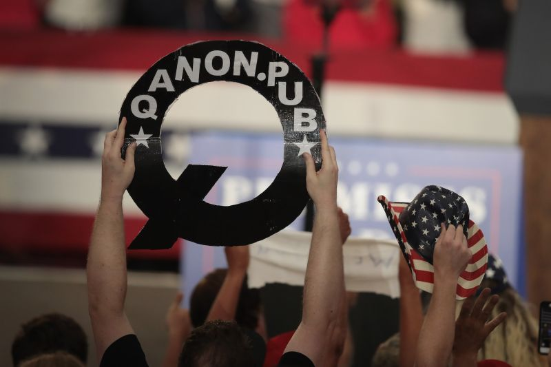 "A Trump supporter holds a ""Q"" sign at a rally in Ohio on Aug. 4, 2018."
