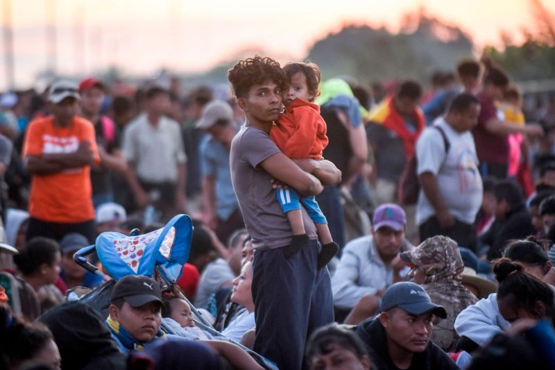 A Central American migrant and his child