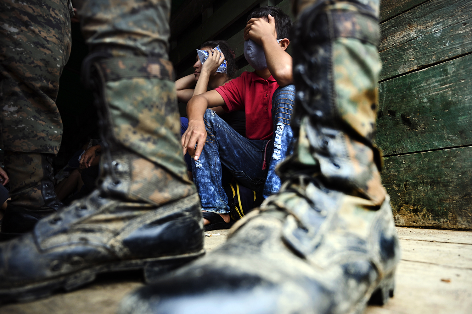 Honduran migrants who had been heading to the United States sit in an army truck in Entre Rios, Guatemala, on Oct. 2 after agreeing to return to their country. JOHAN ORDONEZ/AFP via Getty Images