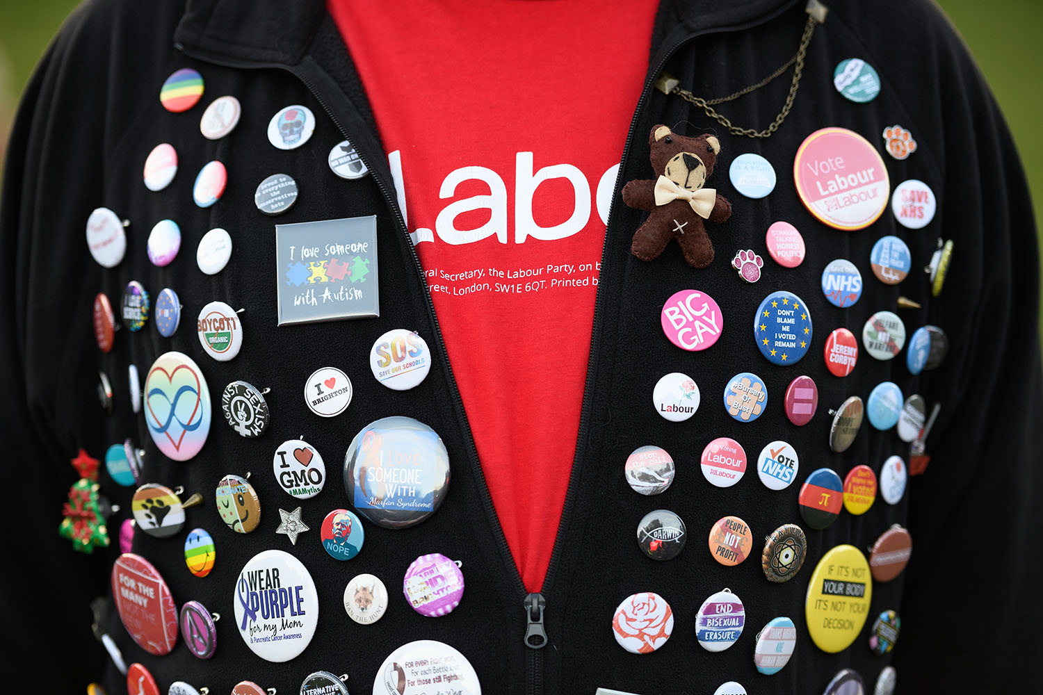 A Labour Party supporter shows off his collection of badges ahead of a speech by Labour Party leader Jeremy Corbyn at a Momentum rally in Brighton, England, on Sept. 23, 2017.