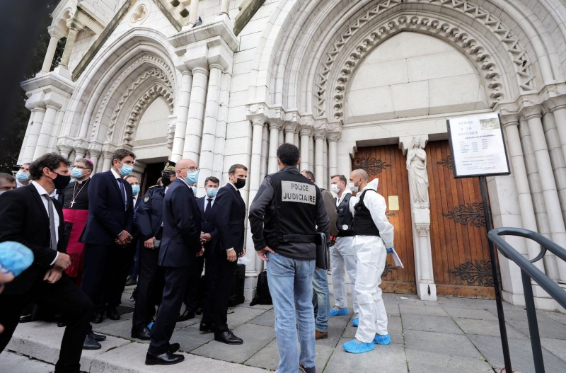 Right-wing party Les Republicains (LR) MP Eric Ciotti, French President Emmanuel Macron and Nice Mayor Christian Estrosi visit the scene of a knife attack at the Basilica of Notre-Dame de Nice in Nice on October 29, 2020.