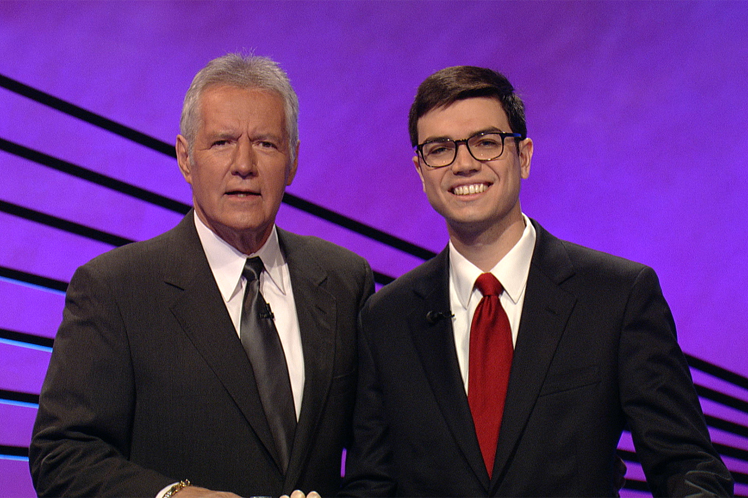 Trump administration official Michael Ellis (right) is pictured with <em>Jeopardy!</em> host Alex Trebek after Ellis appeared on the game show in April 2013.