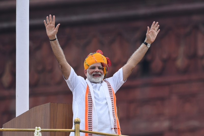Indian Prime Minister Narendra Modi waves at the crowd during celebrations of the country's 73rd Independence Day, at the Red Fort in New Delhi on Aug. 15, 2019.
