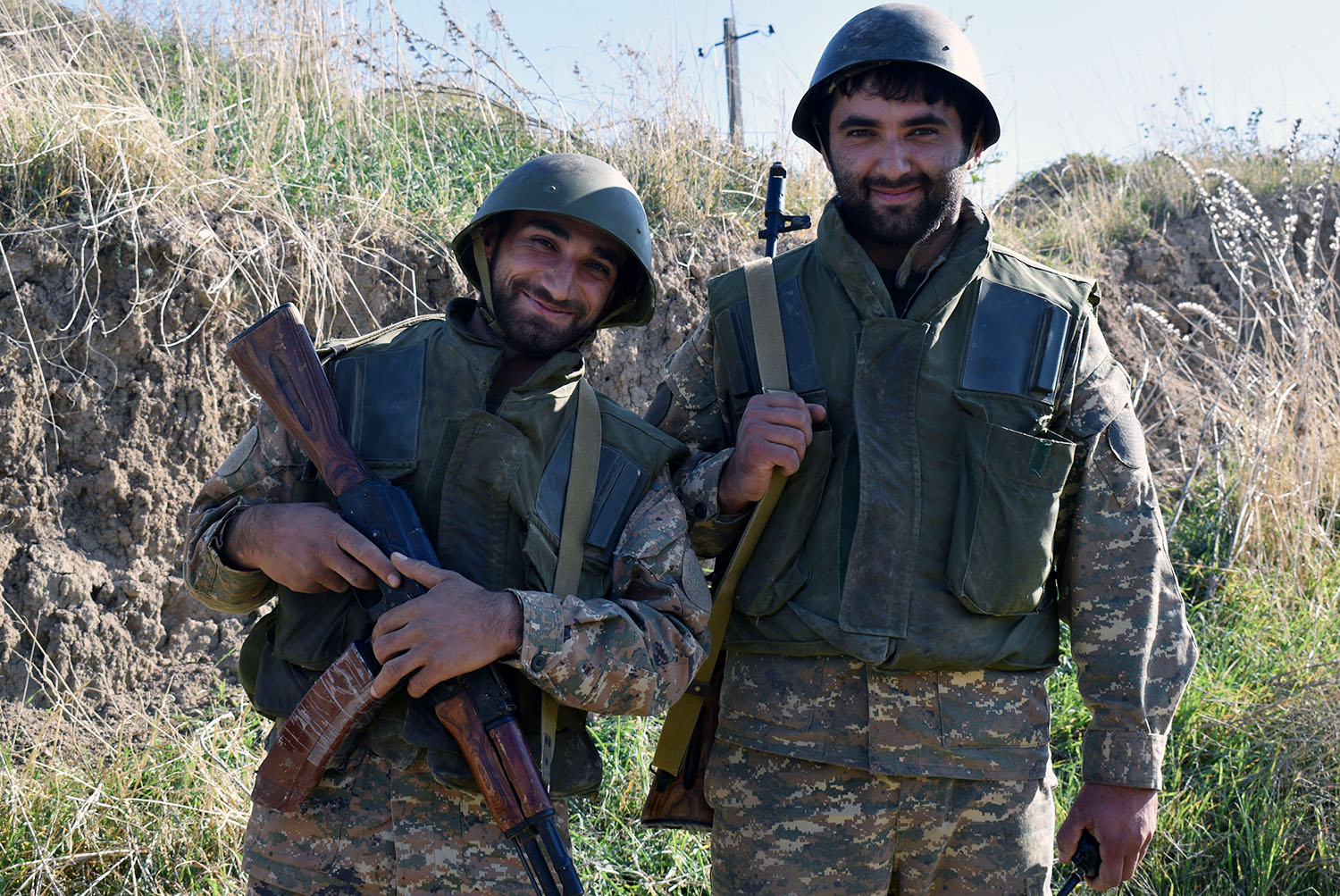 Laert, 27, a construction worker, and Artak, 26, who works in agriculture, both from Martuni near Nagorno-Karabakh's front line, volunteer for the army on Oct. 25. Both withheld their last names out of concern for their safety.