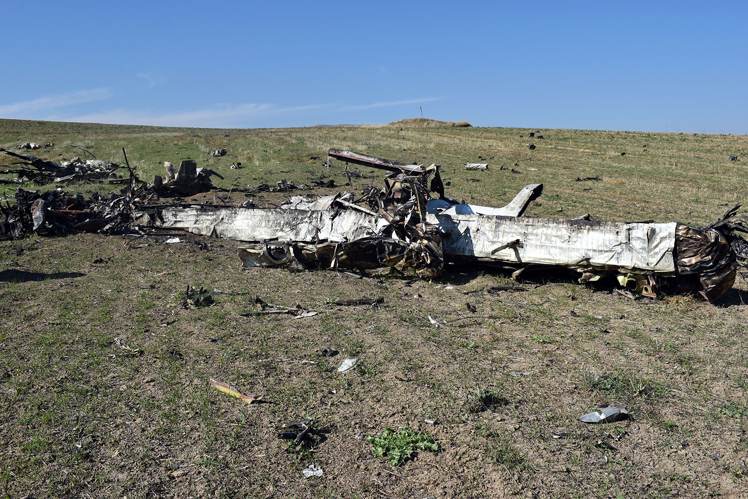 A drone that Artsakh Defense Army soldiers claim they downed near Martuni, Armenia, close to the front line with Azerbaijan, on Oct. 25. Soldiers say it is a Soviet-era An-2 biplane that has been repurposed and fitted with explosives for bombing attacks.