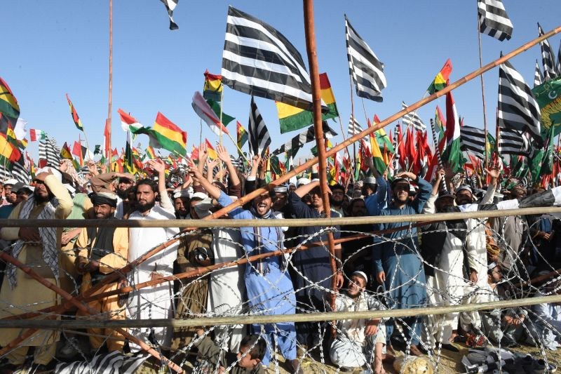 Supporters of the opposition Pakistan Democratic Movement carry their parties' flags during an anti-government rally in Quetta on Oct. 25.