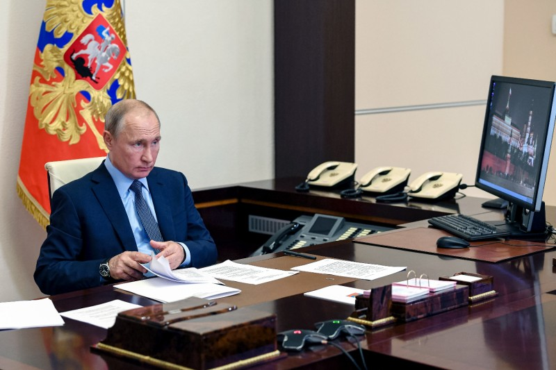 Russian President Vladimir Putin attends a meeting with health workers via videoconference at the Novo-Ogaryovo state residence outside Moscow on June 20.