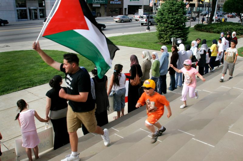 Lebanese, Palestinian, and Iraqi Americans form a human chain during an Arab unity rally in front of Dearborn City Hall in Dearborn, Michigan, on June 6, 2007.