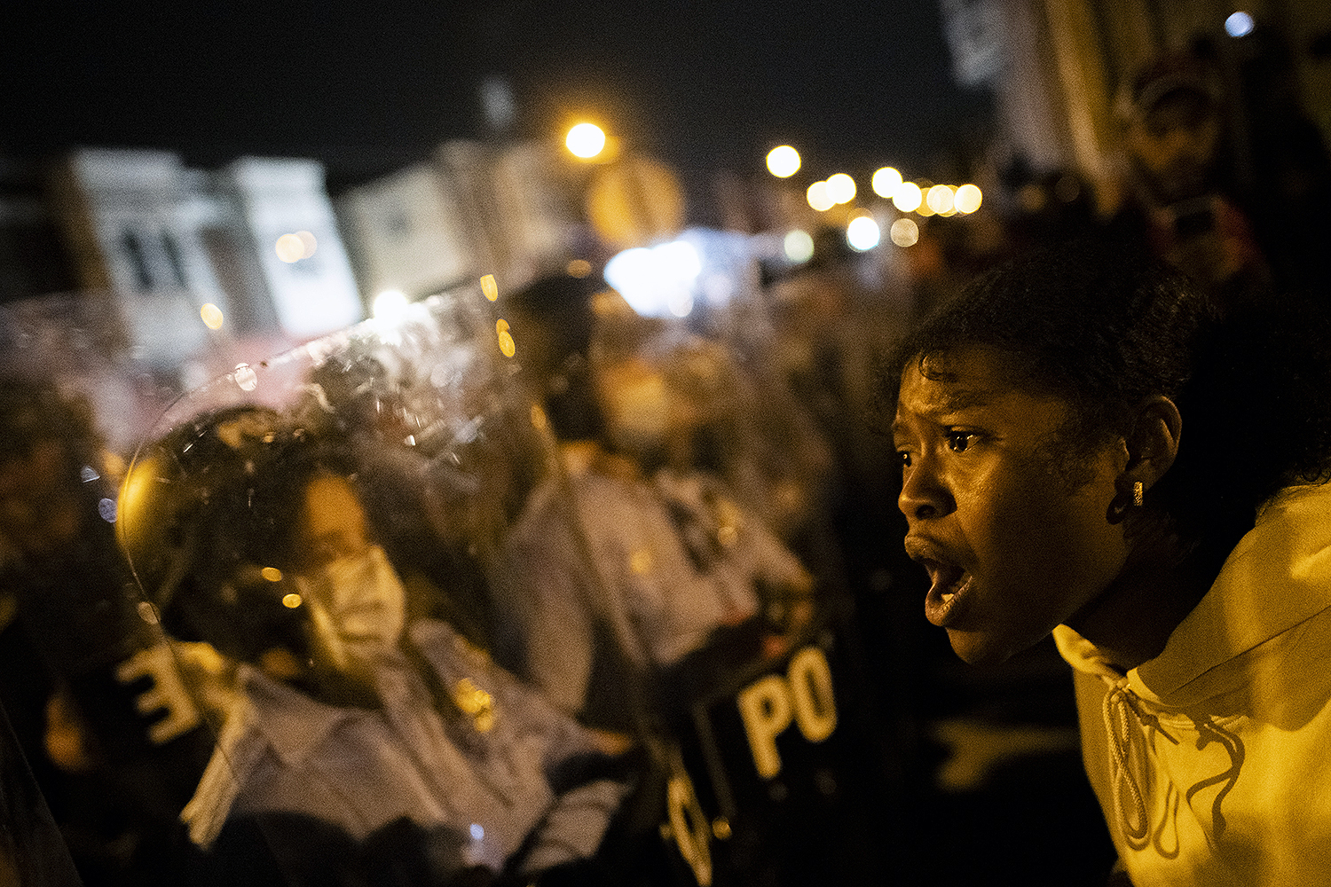 A demonstrator screams at a line of police officers during a protest in Philadelphia on Oct. 27 near the spot where Walter Wallace Jr. was killed by two police officers a day earlier. Protests erupted after the fatal shooting of 27-year-old Wallace Jr., a Black man who police say was armed with a knife but whose parents say was bipolar and in crisis at the time of his death. Mark Makela/Getty Images