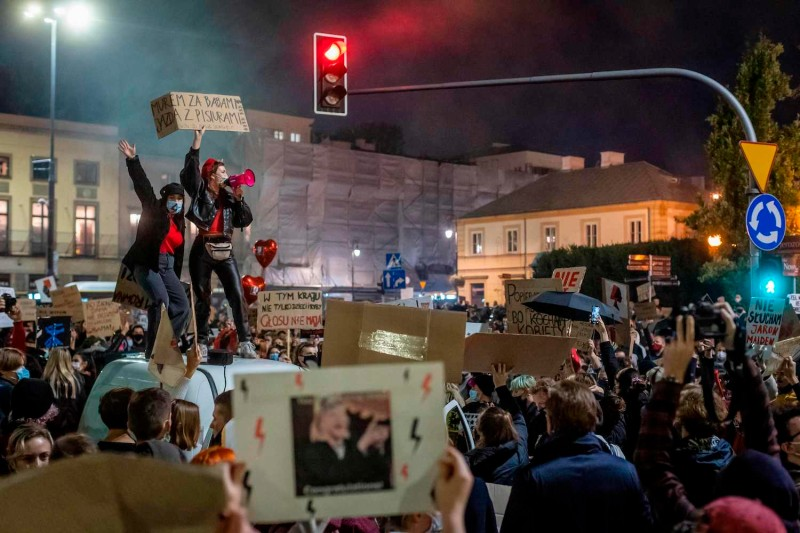 People block traffic in the center of Warsaw during a protest against a decision by the Constitutional Court on abortion law restriction, Warsaw, October 26, 2020,