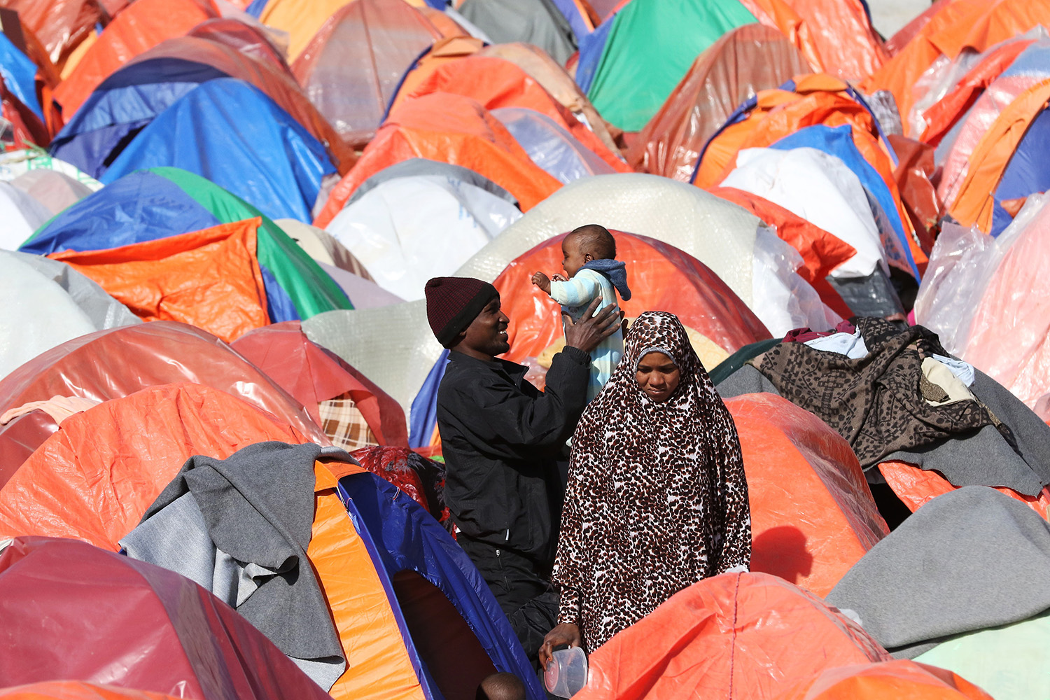 Sudanese refugees from Darfur gather amid tents during a sit-in outside the United Nations High Commissioner for Refugees in the Jordanian capital Amman on Dec. 12, 2015, demanding better treatment and acceleration of their relocation.