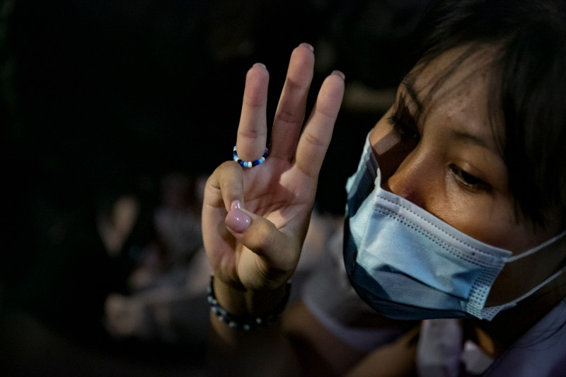 A protester gives the three-finger salute at a rally outside Nonthaburi police station in Bangkok on Oct. 19.