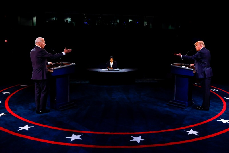 U.S. President Donald Trump, Democratic presidential candidate Joe Biden, and moderator Kristen Welker participate in the final presidential debate at Belmont University in Nashville, Tennessee, on Oct. 22.