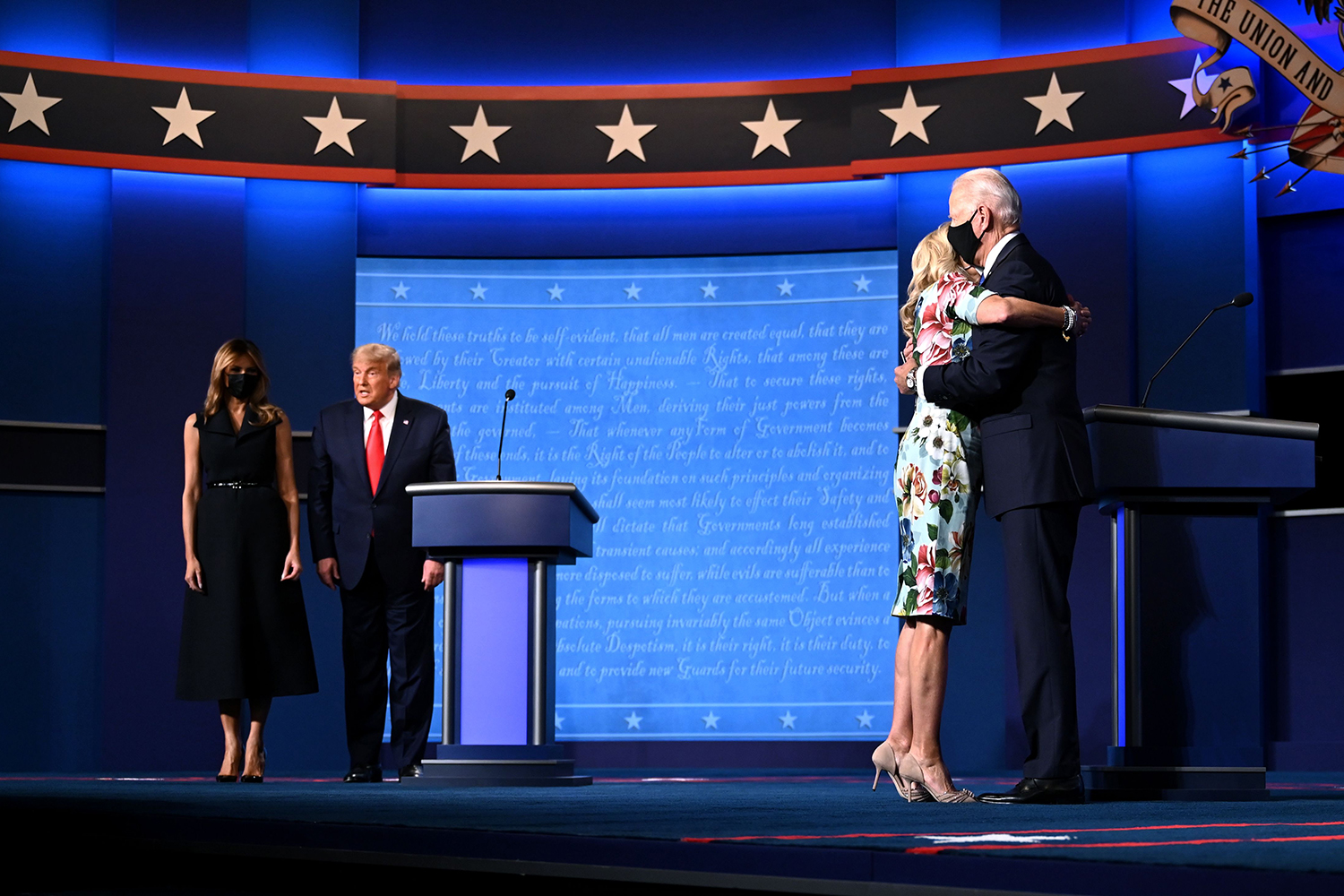 U.S. First Lady Melania Trump, far left, stands with her husband, President Donald Trump, as Jill Biden, right, hugs husband and former Vice President Joe Biden, the Democratic nominee, at the end of the final presidential debate in Nashville, Tennessee, on Oct. 22. JIM WATSON/AFP via Getty Images