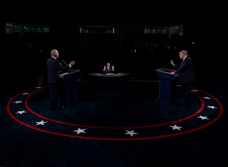 US President Donald Trump (R) and former Vice President and Democratic presidential nominee Joe Biden participate in the first presidential debate at the Health Education Campus of Case Western Reserve University on September 29, 2020 in Cleveland, Ohio.