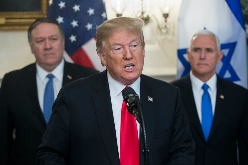 President Donald Trump speaks alongside Secretary of State Mike Pompeo and Vice President Mike Pence.