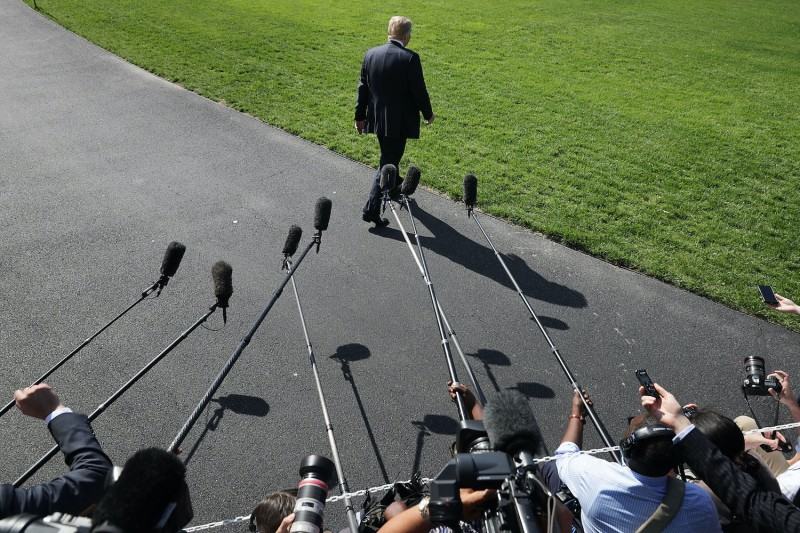 President Donald Trump departs after speaking to media at the White House.