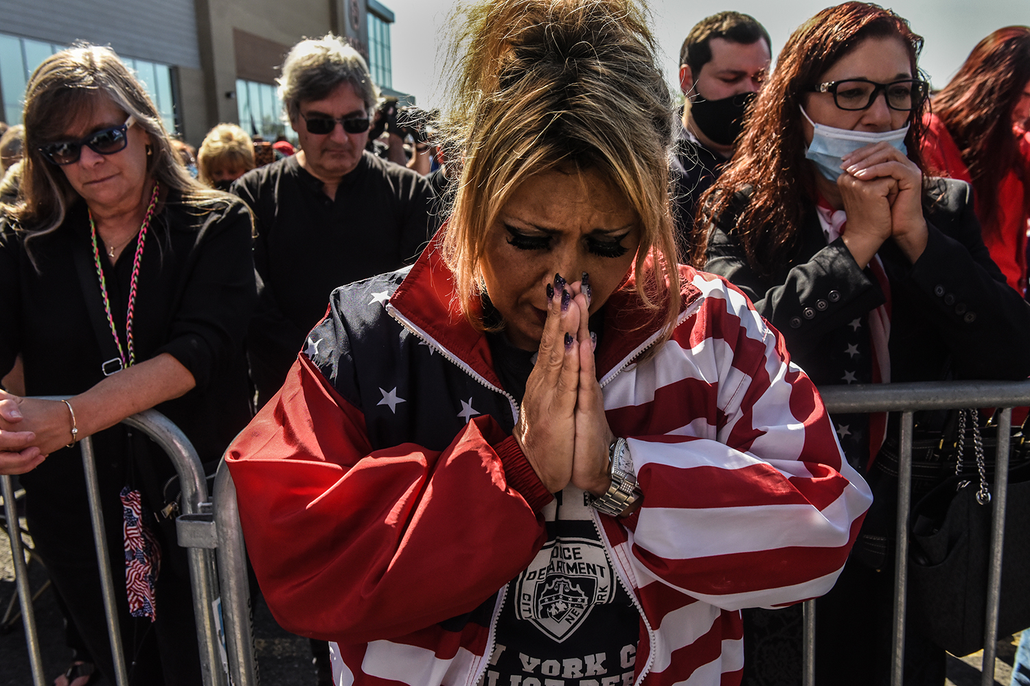 Daniela Taormina prays during a pro-Trump rally in the Staten Island borough of New York City on Oct. 3 after news that the president had fallen ill with COVID-19. Stephanie Keith/Getty Images