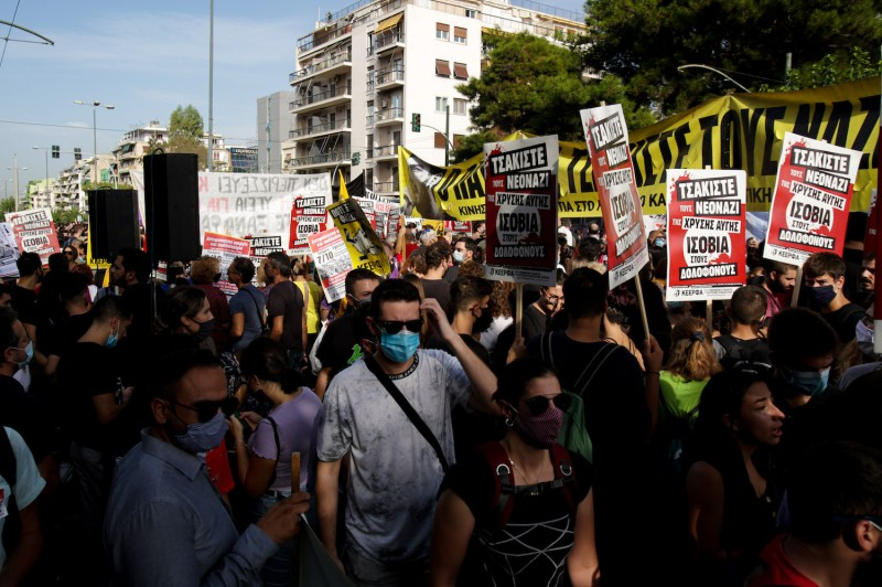 Anti-fascist protesters outside the court in Athens, Greece, where the trial of leaders and members of the Golden Dawn far-right party is taking place on Oct. 7.