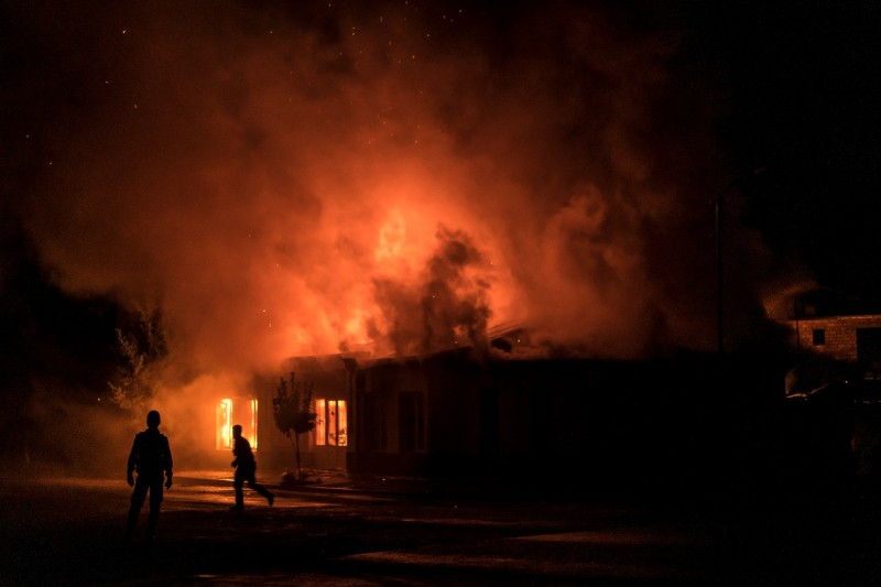A fire burns in a hardware store after a rocket attack in Stepanakert, Nagorno-Karabakh, on Oct. 3.