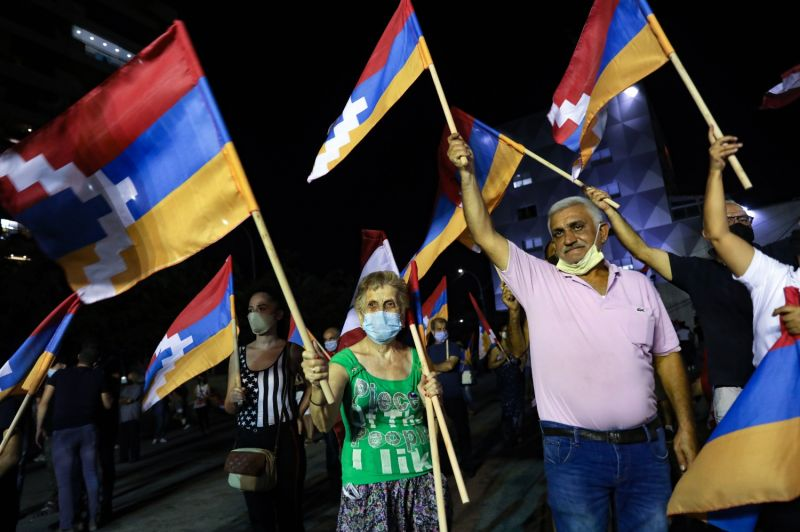Lebanese of Armenian origin raise Armenian and Nagorno-Karabakh flags as they take part in a rally in Beirut's neighborhood of Bourj Hammoud on Oct. 9.