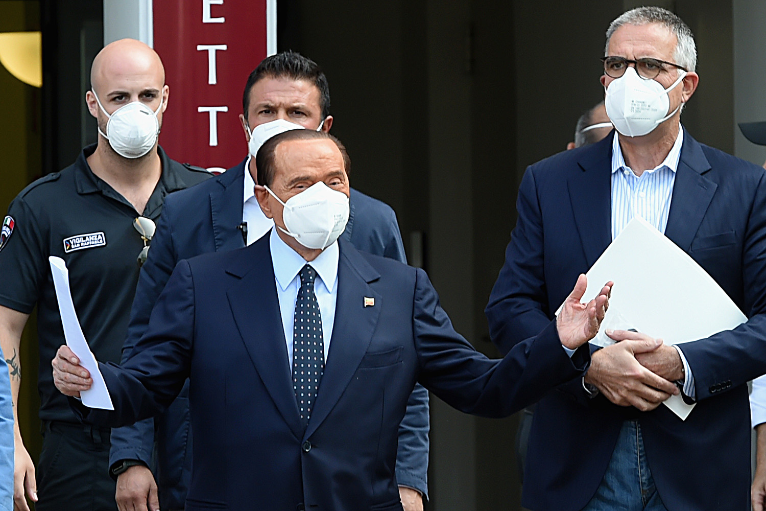Former Italian Prime Minister Silvio Berlusconi is discharged from the San Raffaele hospital in Milan on Sept. 14 after being treated for COVID-19.