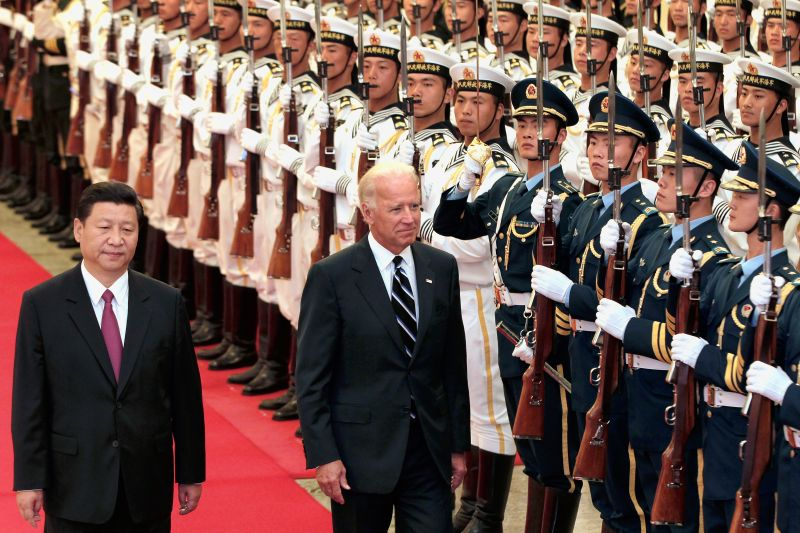 Chinese then-Vice President Xi Jinping and U.S. then-Vice President Joe Biden view an honor guard inside the Great Hall of the People on Aug. 18, 2011 in Beijing.