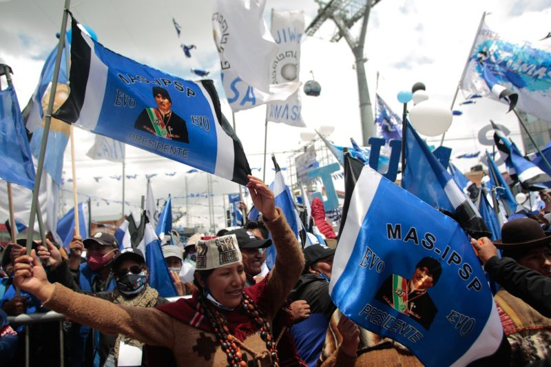 Demonstrators hold flags with the face of former president Evo Morales during a Movement for Socialism closing rally ahead of presidential elections in El Alto, Bolivia, on Oct. 14.