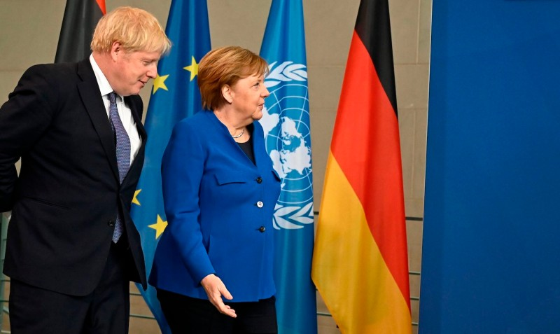 U.K Prime Minister Boris Johnson and German Chancellor Angela Merkel during a peace summit on Libya.