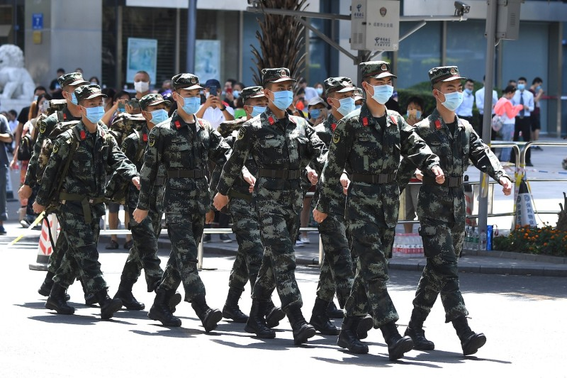 Paramilitary police march near the U.S. consulate in Chengdu, China.