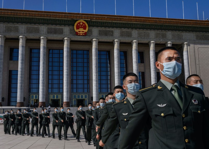 Chinese soldiers from the People's Liberation Army march after a ceremony marking the 70th anniversary of China's entry into the Korean War, on Oct. 23 in Beijing.