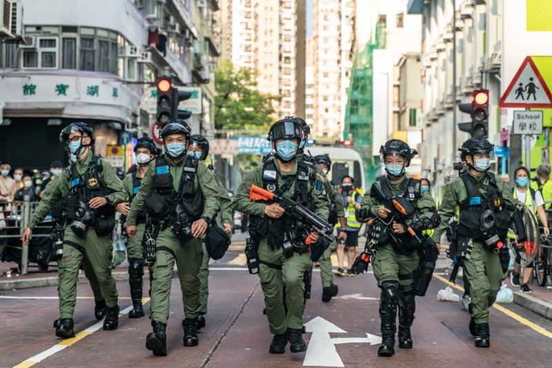 Riot police march through Hong Kong during an anti-government demonstration on Sept. 6.
