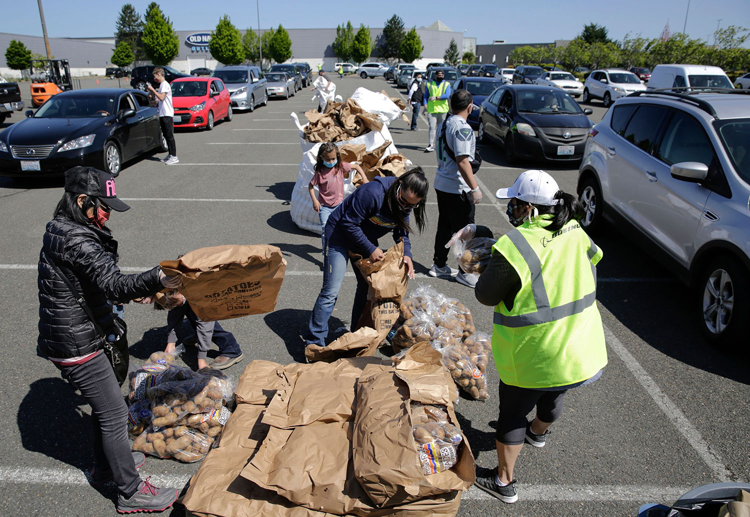Volunteers hand out excess potatoes donated by Washington farmers as a result of the food-service industry slowdown during the coronavirus pandemic in Auburn, Washington, on May 7.