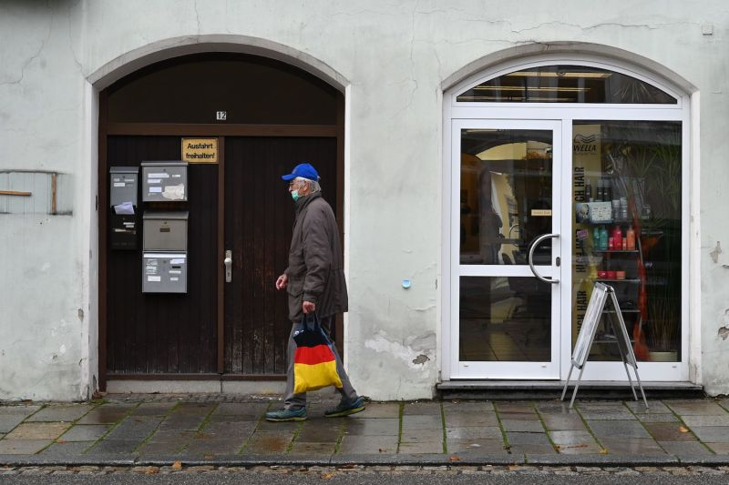 A partially-masked man walks in Pfarrkirchen, a town in Bavaria, on Oct. 27 after a local lockdown was imposed.
