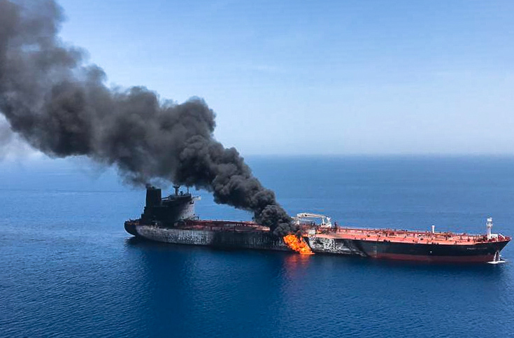 Fire and smoke billow from a Norwegian-owned tanker reported to have been attacked in the Gulf of Oman, in a photo obtained on June 13, 2019.