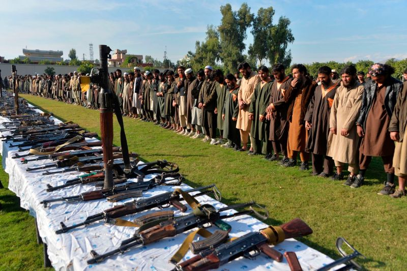 Members of the Islamic State stand alongside their weapons, following their surrender to Afghanistan's government in Jalalabad on Nov. 17, 2019.